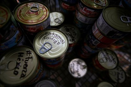 "A tin can with the writing ""We are with you"" is seen at a collection centre for people affected by an earthquake in Mexico City, Mexico September 22, 2017. REUTERS/Jose Luis Gonzalez"