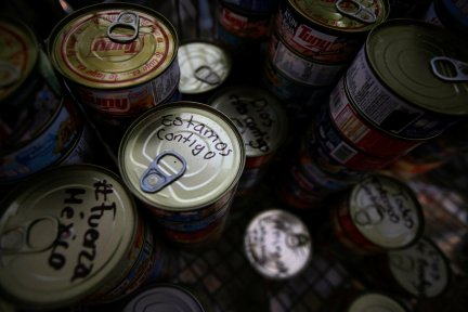 """A tin can with the writing """"We are with you"""" is seen at a collection centre for people affected by an earthquake in Mexico City, Mexico September 22, 2017. REUTERS/Jose Luis Gonzalez"""